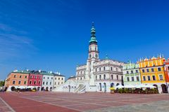 Zamosc, Poland. Historic buildings with the town hall. Zamosc, Poland. Historic buildings with the town hall in the Great Market. Panorama view Royalty Free Stock Photo