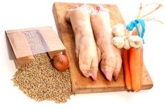 Zampone, lenticchie e verdure del maiale Immagini Stock