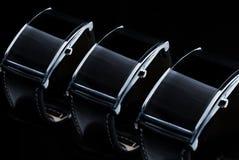 Zamyka up czarny mądrze zegarka lub wristwatch set Obrazy Stock