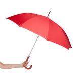 Zamyka up czerwony parasol w ręce Zdjęcia Stock