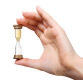Zamyka up kobiety ręki mienia hourglass Obraz Royalty Free