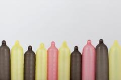 Zamyka up kolorowi kondomy zdjęcia stock