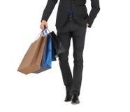Zamyka up mężczyzna w kostiumu z torba na zakupy Fotografia Stock