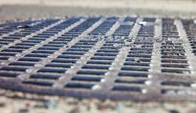 Zamyka up metalu manhole pokrywa Zdjęcia Royalty Free
