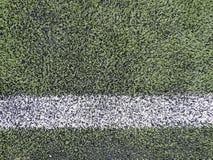 Zamyka up na boisku piłkarskim z sztuczną trawą Zdjęcia Stock
