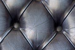 Zamyka up na czarnym skóry kanapy tekstury tle Pub w Londo Obrazy Royalty Free