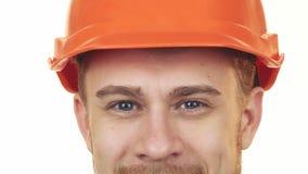 Zamyka up oczy szczęśliwy pracownik budowlany jest ubranym hardhat obraz stock