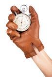 Zamyka Up ręki mienia Stopwatch Na Białym tle fotografia stock