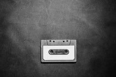 Zamyka up retro rocznik audio kasety taśma na czarnym tle Fotografia Stock