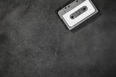 Zamyka up retro rocznik audio kasety taśma na czarnym tle Zdjęcie Royalty Free
