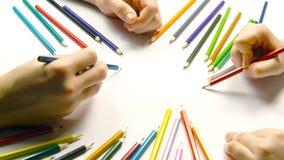 Zamyka up samiec i kobiety ręk rysować Fotografia Stock