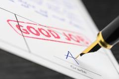 Zamyka up stemplowa dobra praca i ocenia a na dokumencie Obraz Stock