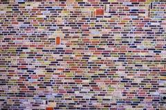 Zamyka w górę kolorowej ściany z cegieł tekstury zdjęcia stock