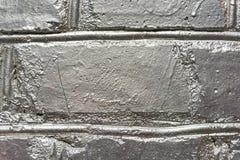 Zamyka w górę ściana z cegieł malującego w srebrze obrazy stock