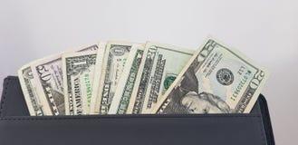 Zamyka w górę amerykańskich dolarowych rachunków w kieszeni zdjęcia stock