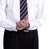 Zamyka w górę biznesmena klascze jego ręki zdjęcie royalty free