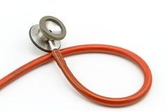 Zamyka w górę blendy różowy stetoskop na białym tle Zdjęcia Stock