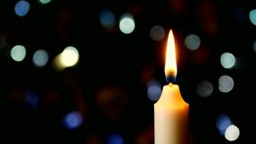 Zamyka w górę Bożenarodzeniowego Wakacyjnego świeczka płomienia lk zbiory