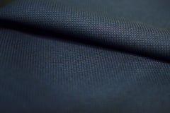 Zamyka w górę deseniowego tekstura zmroku - błękitna tkanina kostium Fotografia Royalty Free