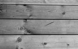 Zamyka w górę Drewnianych podłogowych desek na czarny white struktura fotografia stock