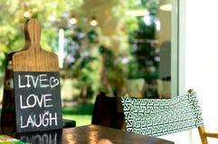 Zamyka w górę etykietki ` miłości śmiechu ŻYWY ` Fotografia Stock