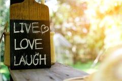 Zamyka w górę etykietki ` miłości śmiechu ŻYWY ` Zdjęcie Royalty Free