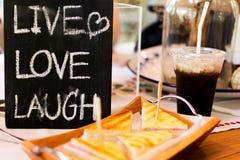 Zamyka w górę etykietki ` miłości śmiechu ŻYWY ` Obraz Stock