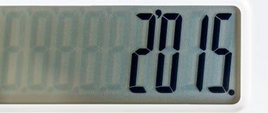 Zamyka w górę fotografii biały koloru kalkulator stawiający na czerni Zdjęcia Stock