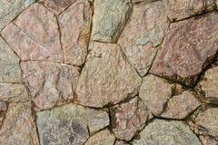 Zamyka w górę grunge kamiennej ściany ampuła barwiący cement fotografia stock
