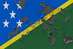 Zamyka w górę grungy, uszkadzający i wietrzeć Solomon wyspy zaznaczają na ścianie struga daleko farbę widzieć wśrodku powierzchni obraz royalty free