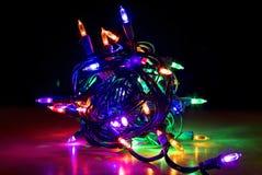 Zamyka W górę Kolorowego Rozjarzonego plika DOWODZENI bożonarodzeniowe światła fotografia royalty free