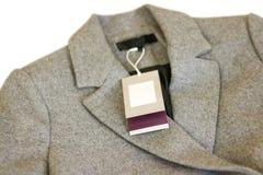Zamyka w górę metki popielaty wełna żakiet Odziewa, odzież i moda Obrazy Royalty Free