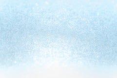 Zamyka w górę miękkiego błękitnego papieru błyskotliwości bokeh abstrakta tła Zdjęcia Royalty Free