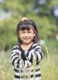 Zamyka w górę twarzy azjatykcich dzieci twarzy szczęścia toothy uśmiechnięty em Obraz Royalty Free