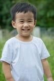 Zamyka w górę uśmiechniętej twarzy azjatykci dzieci patrzeje kamera Obraz Royalty Free