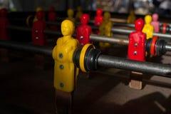 Zamyka w górę widoku żółty gracz na futbolowej zabawce Fotografia Stock