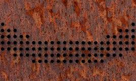 Zamyka w górę widoku dziurkowata brown metal fasada Dziury tworzą wyginającą się linię obrazy royalty free