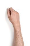 Zamyka w górę widoku man& x27; s ręka trzyma gumkę odizolowywająca na białym tle Zdjęcie Royalty Free