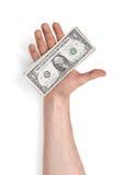 Zamyka w górę widoku man& x27; s ręka trzyma jeden dolarowych rachunki na białym tle Fotografia Stock