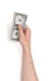 Zamyka w górę widoku man& x27; s ręka trzyma jeden dolarowych rachunki odizolowywający na białym tle Obraz Royalty Free