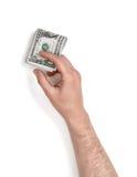 Zamyka w górę widoku man& x27; s ręka trzyma jeden dolarowych rachunki odizolowywający na białym tle Zdjęcia Royalty Free