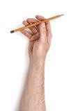 Zamyka w górę widoku man& x27; s ręki mienia ołówek na białym tle Obraz Stock