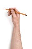 Zamyka w górę widoku man& x27; s ręki mienia ołówek odizolowywający na białym tle Zdjęcia Royalty Free