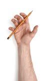 Zamyka w górę widoku man& x27; s ręki mienia ołówek odizolowywający na białym tle Obraz Stock