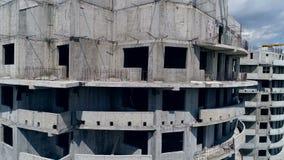 Zamyka w górę widoku najwyższe piętra niedokończony wierza 4K zbiory