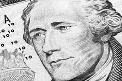 Zamyka w górę widoku portreta Alexander Hamilton na jeden dziesięć dolarowym rachunku Tło pieniądze 10 dolarowy rachunek z Aleksa zdjęcie royalty free