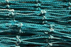 Zamyka w górę zielonej błękitnej sieci rybackiej Makro- texture zdjęcia stock