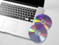 Zamyka w górę klawiaturowego komputeru z cd na bielu. Obrazy Royalty Free