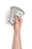 Zamyka w górę widoku man& x27; s ręka trzyma jeden dolarowych rachunki odizolowywający na białym tle Fotografia Royalty Free