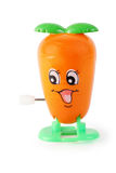 Zanahoria divertida del mecanismo del juguete con la cara Fotografía de archivo